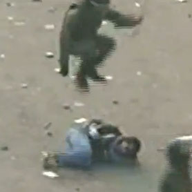 Military police officer jumping on protester