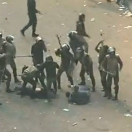 Ten military police officers beating two protesters